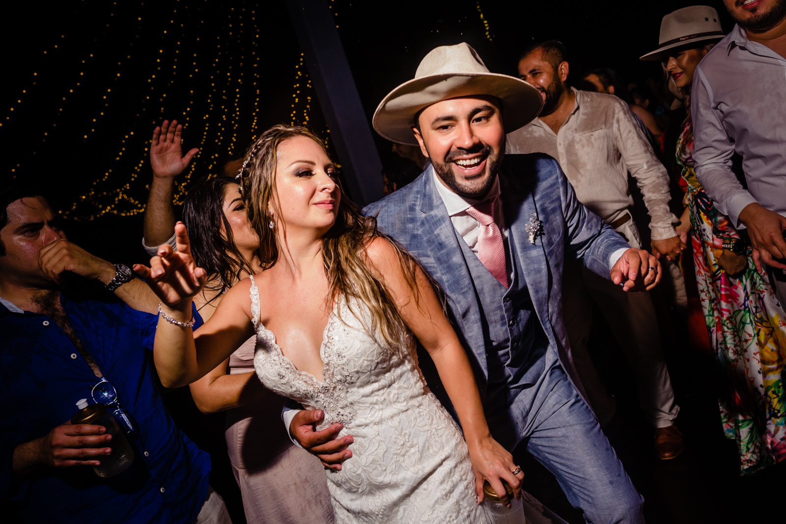 bride and groom dance on the party