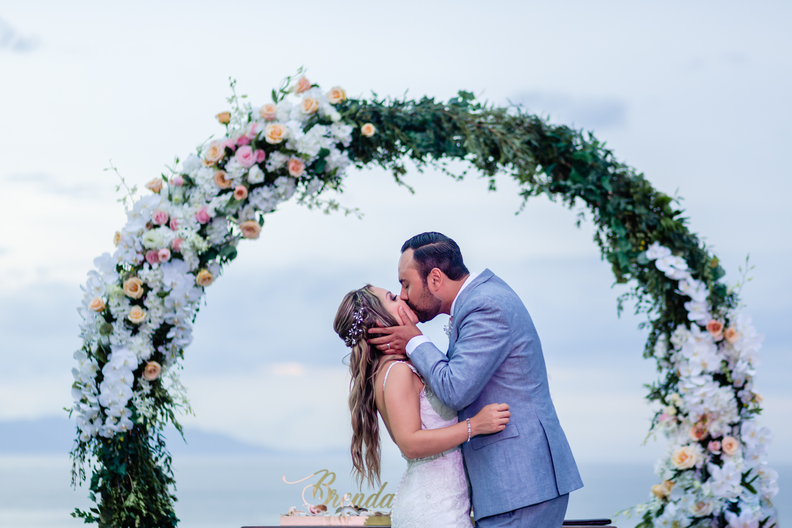 bride and groom kiss at the end of the ceremony
