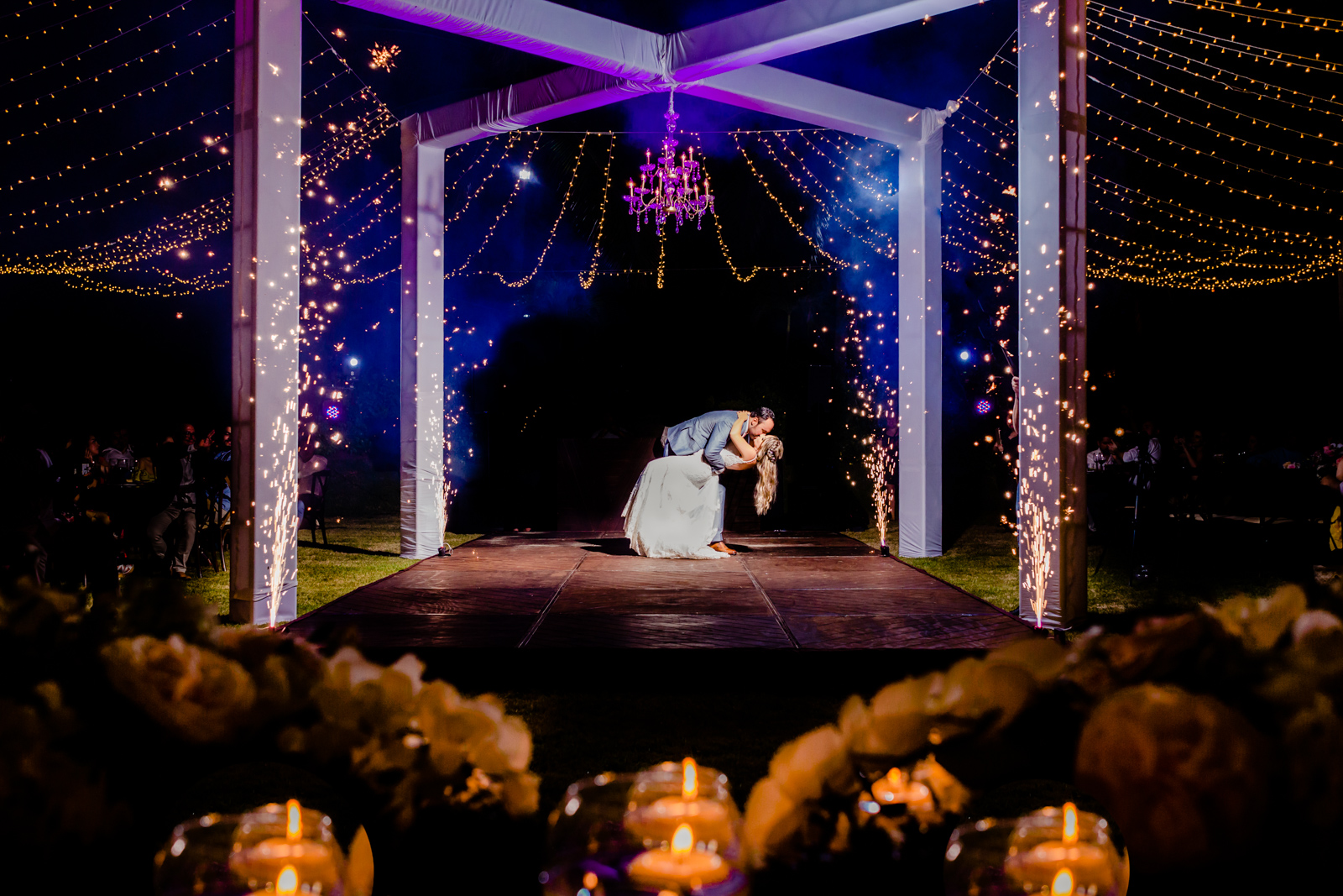 bride and groom kiss during their first dance