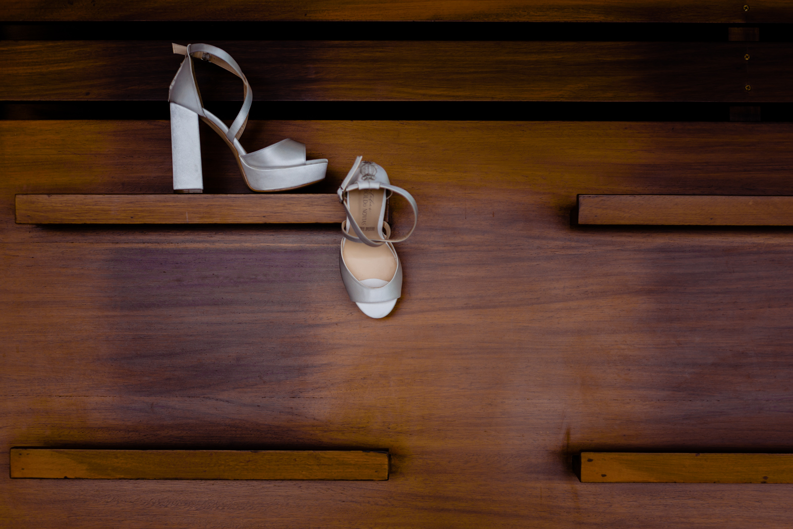 bride's shoes on a wood wall