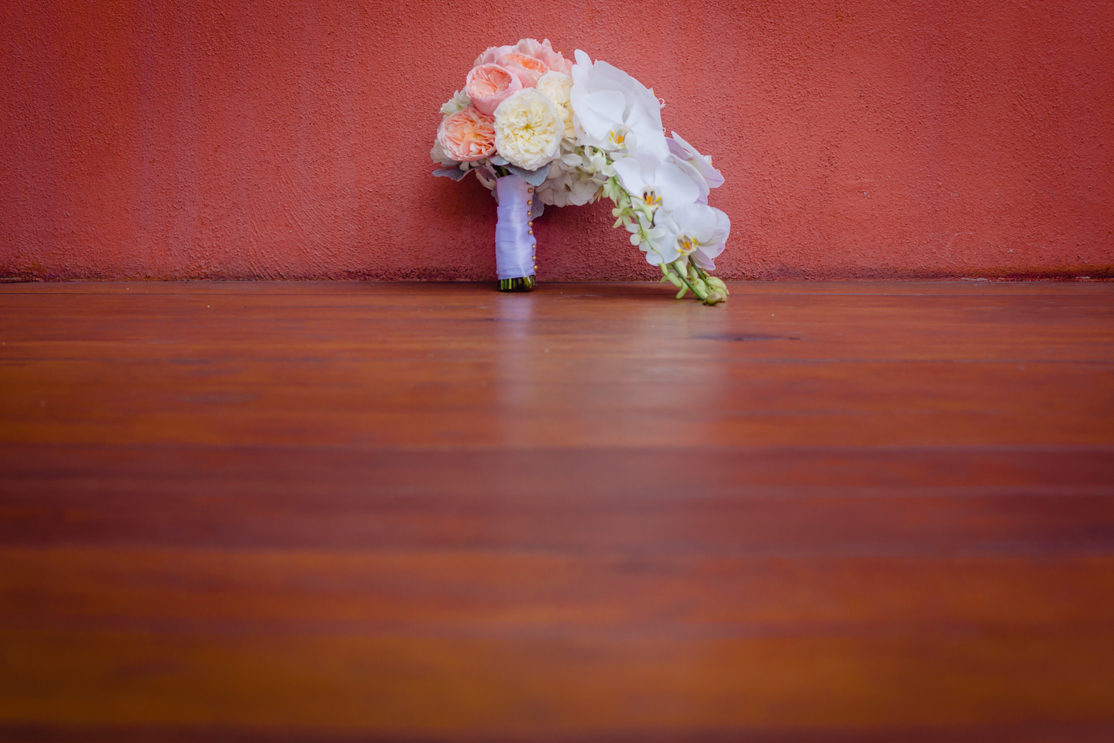 bouquet wedding on a red wall