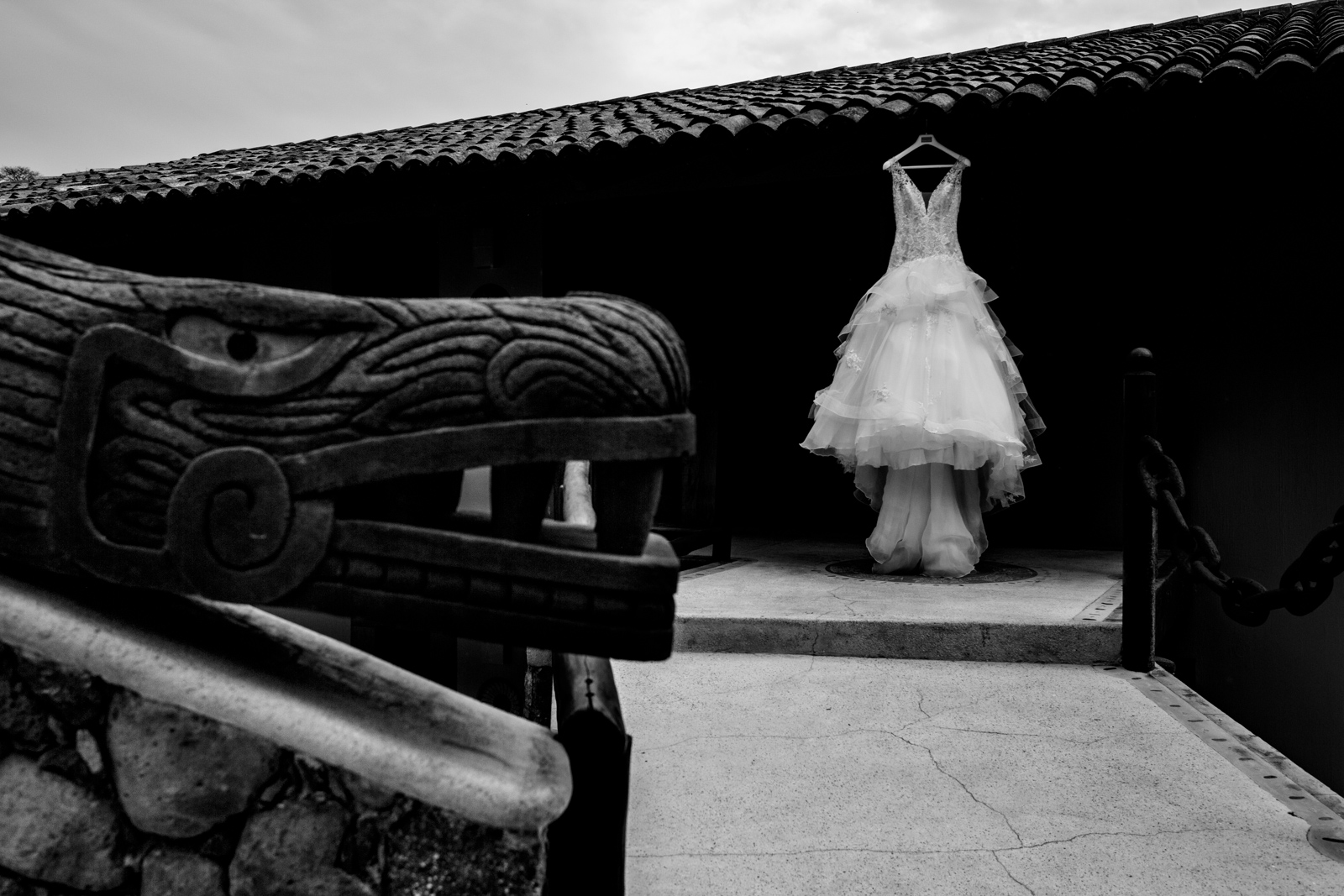 wedding dress hung on a roof with Mexican art
