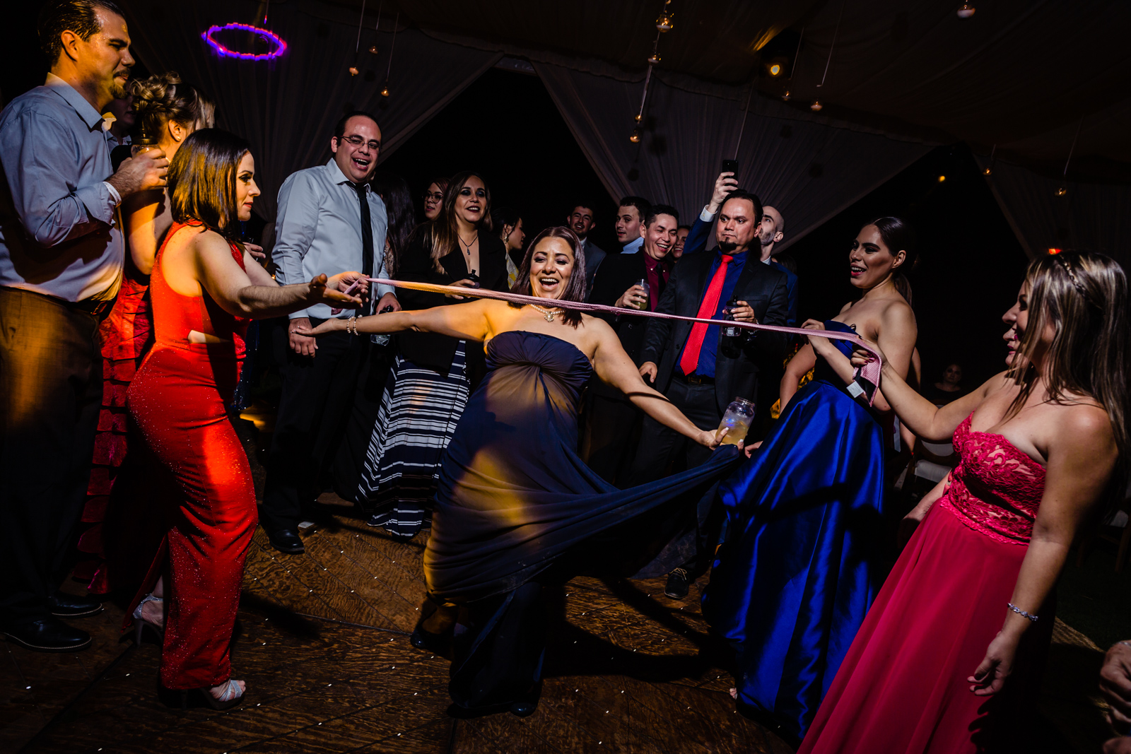 girls having fun on the dance floor play with the tie