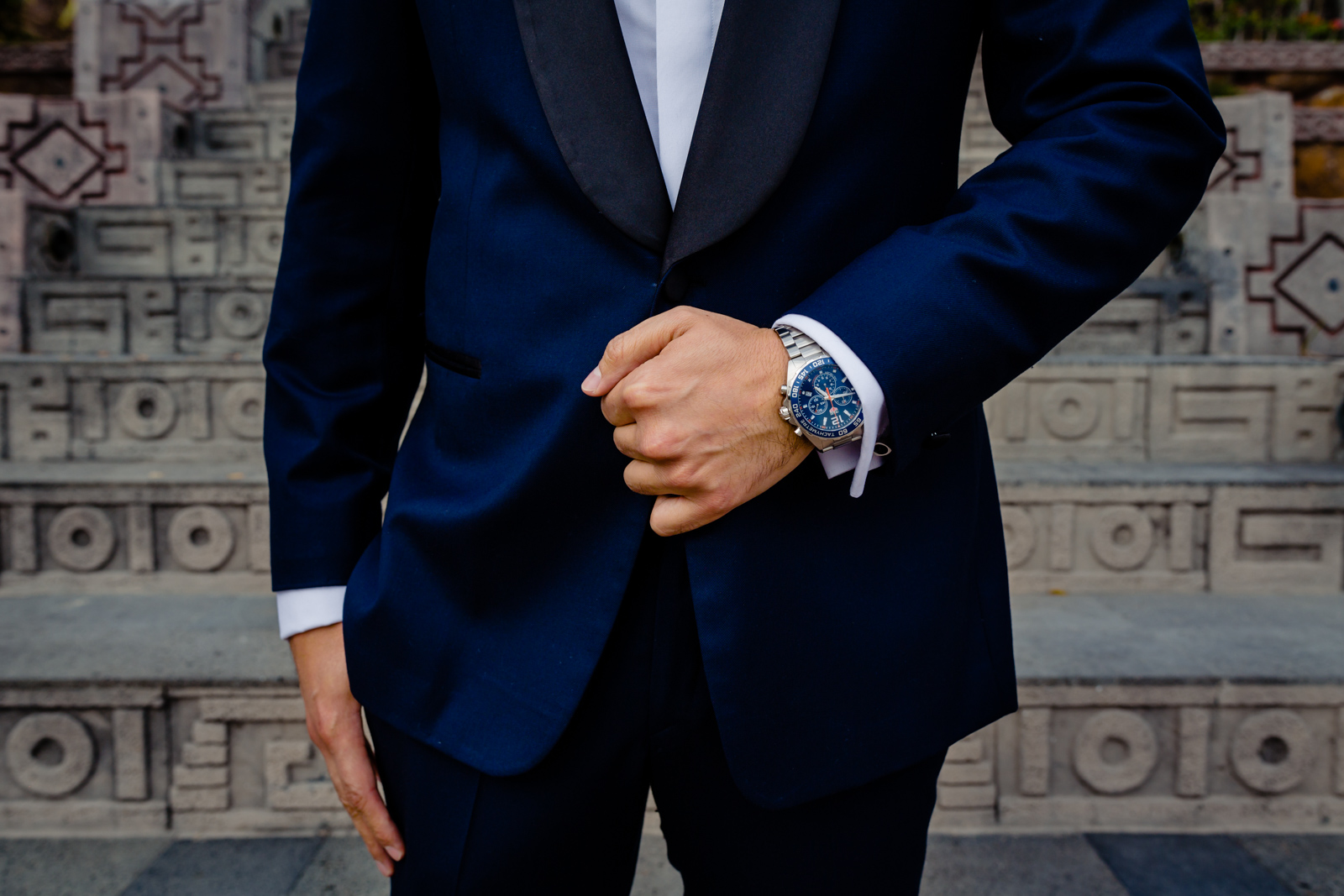 groom details, suit and clock, hands on the pocket