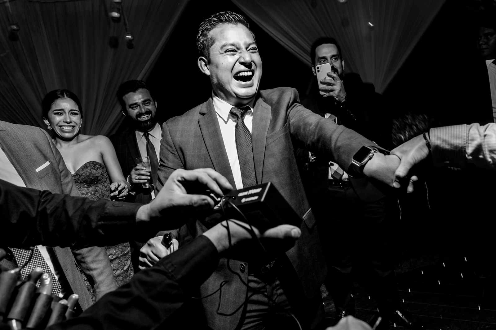 wedding party, guy play with the electric machine and having fun