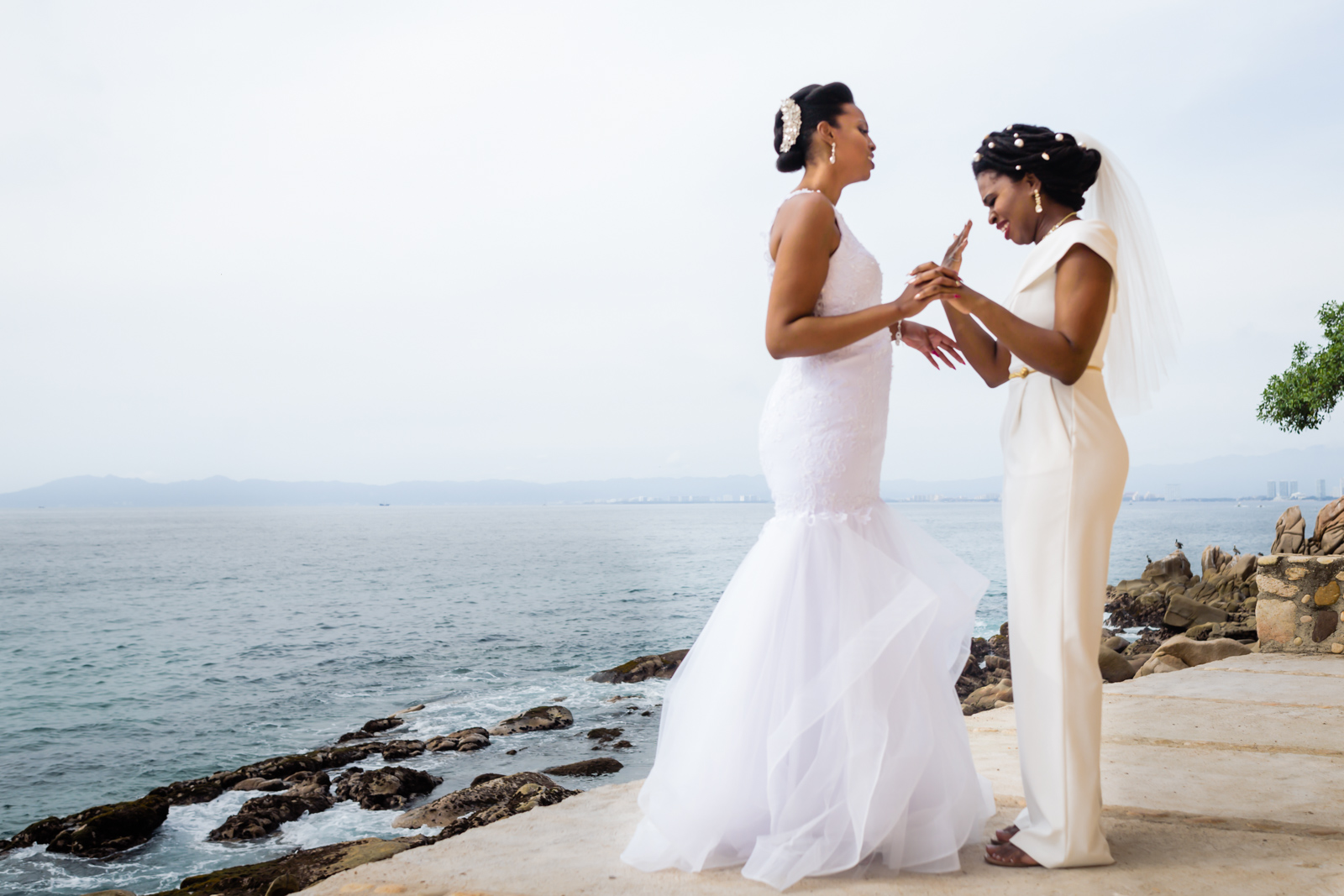 brides first look cry with the ocean in the background