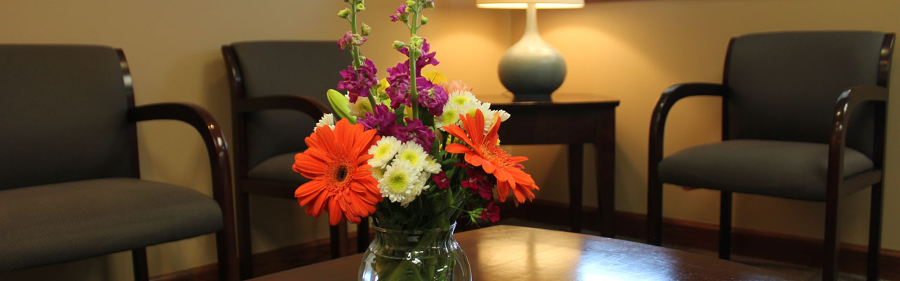 Vase of assorted flowers in the waiting room.