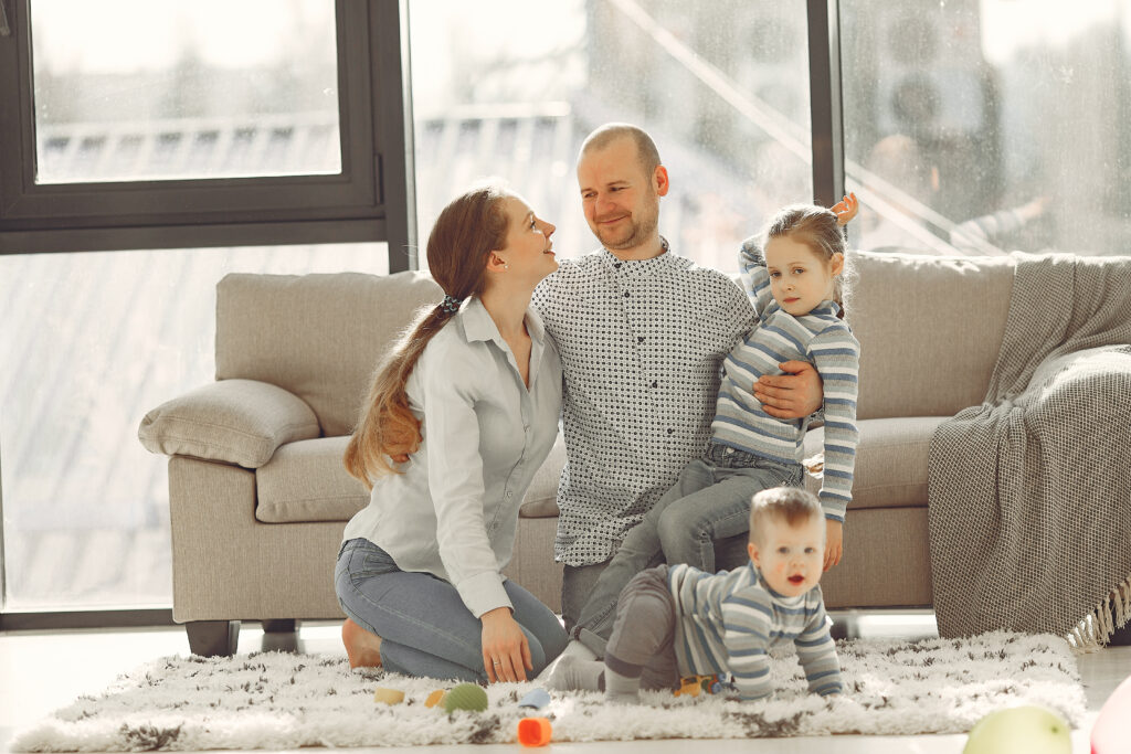 Couple with their kids at the Living room