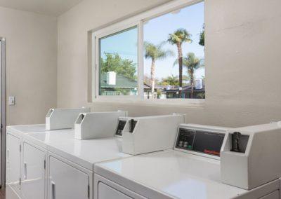 White washing machines in laundry room