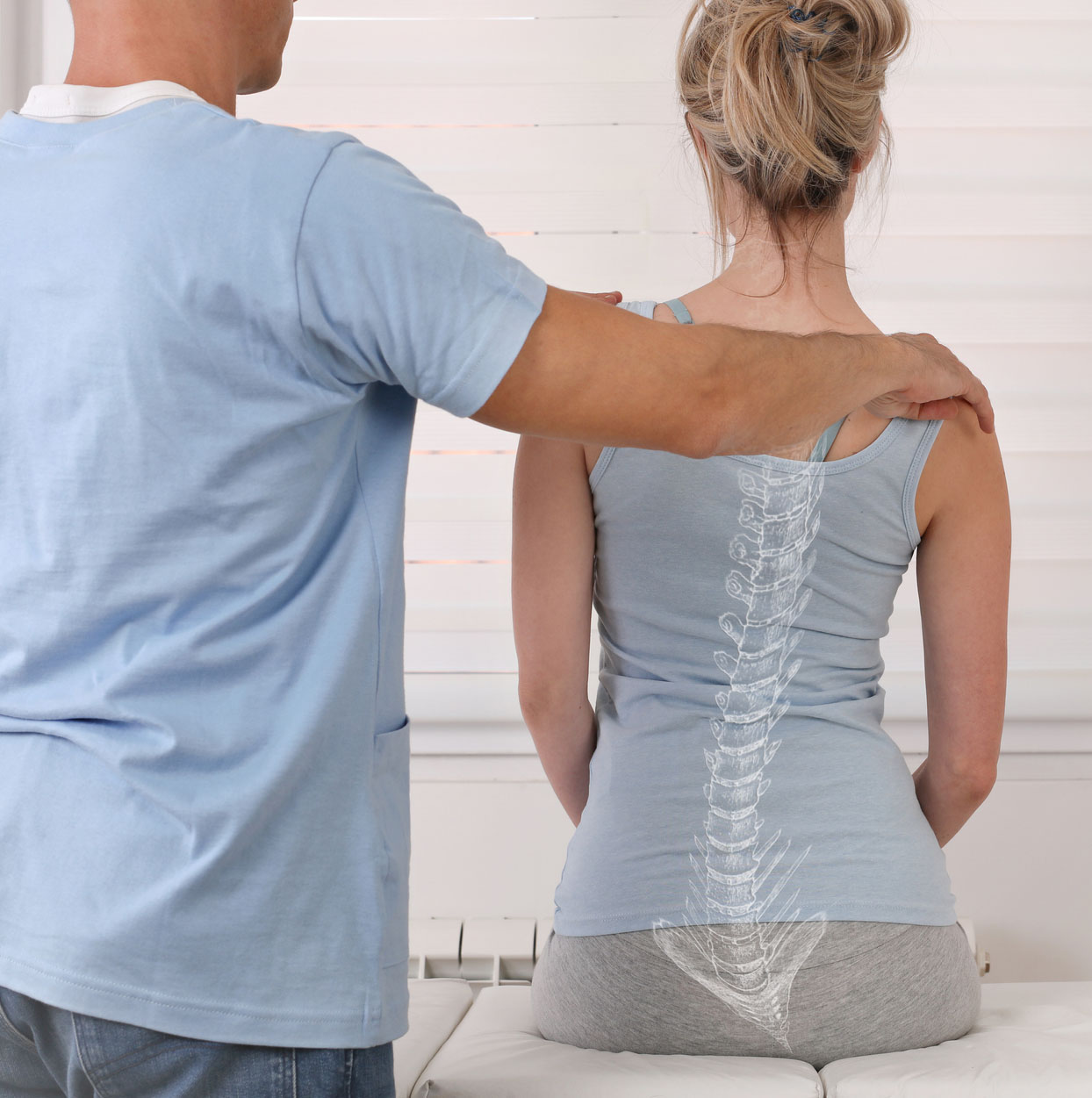 woman being examined by spine surgeon at sierra spine institute for posterior lumbar fusion
