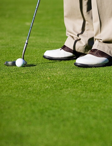 Golfer standing on Bentgrass