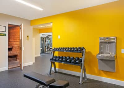 Fitness center with yellow wall and water fountain