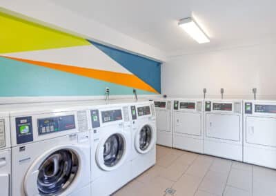 Laundry room with bright wallpaper