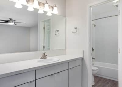 Bathroom with white countertop and bathtub