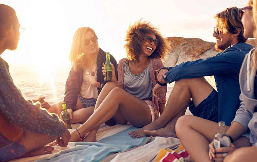 Friends enjoying sunset at the beach