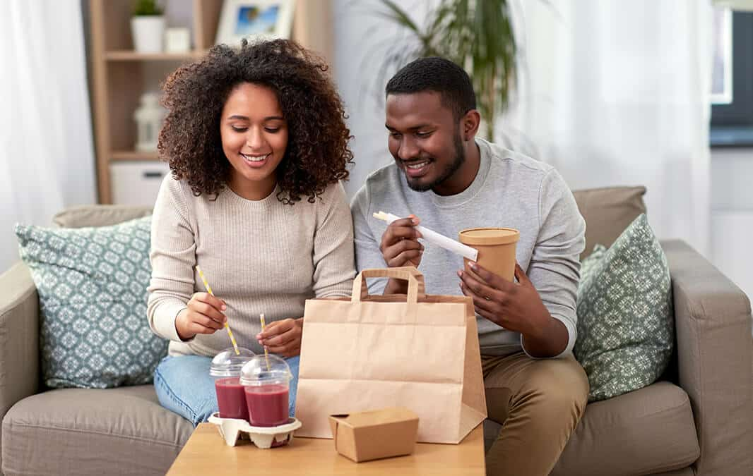 Couple eating takeout food