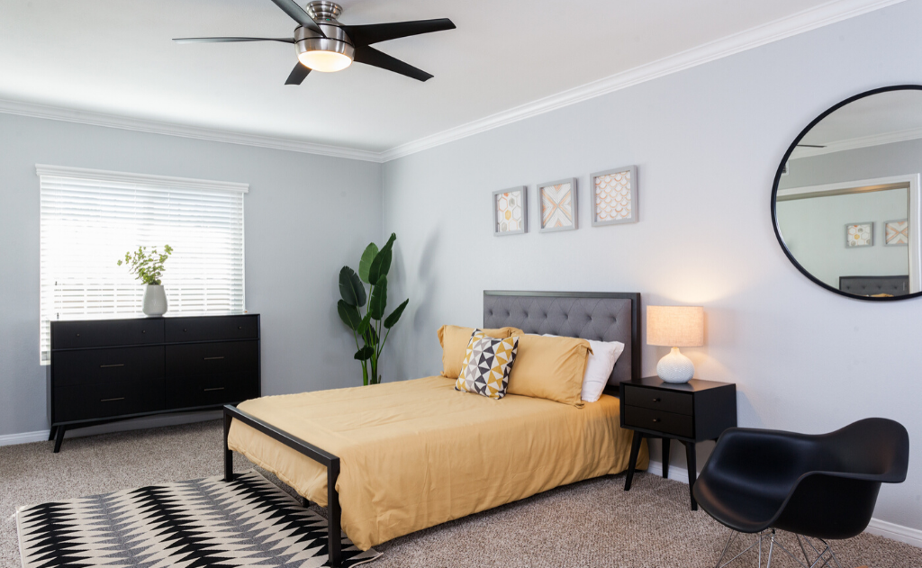 Furnished bedroom with yellow bedding