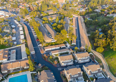 Aerial view of apartment complex with trees and streets