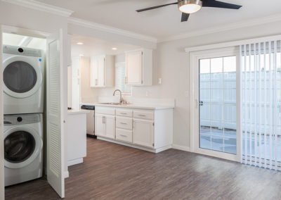 Kitchen/dining room view with washer and dryer