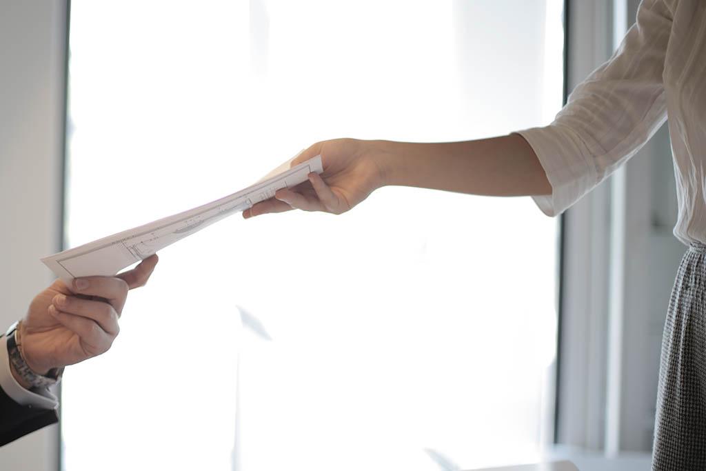 woman handing a resume