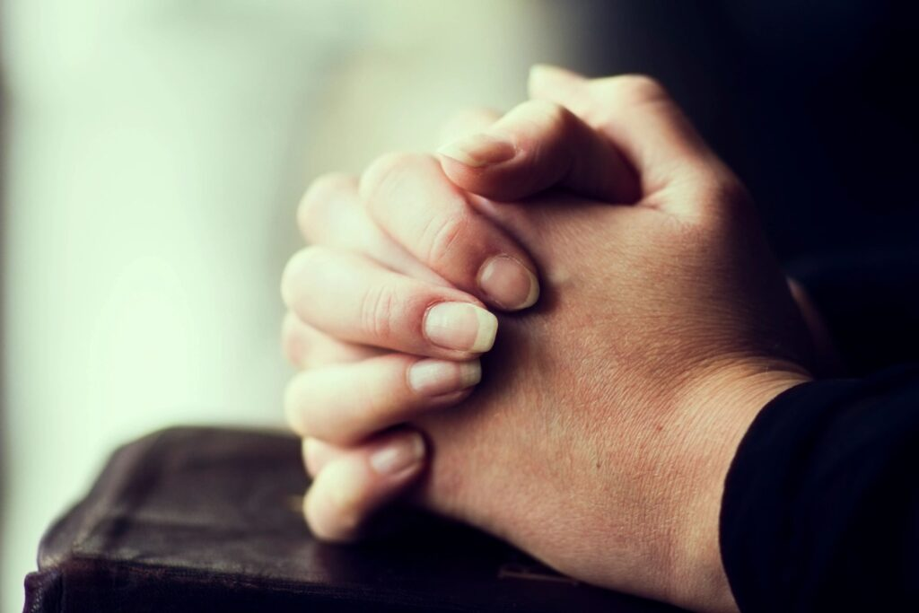 hands of someone praying