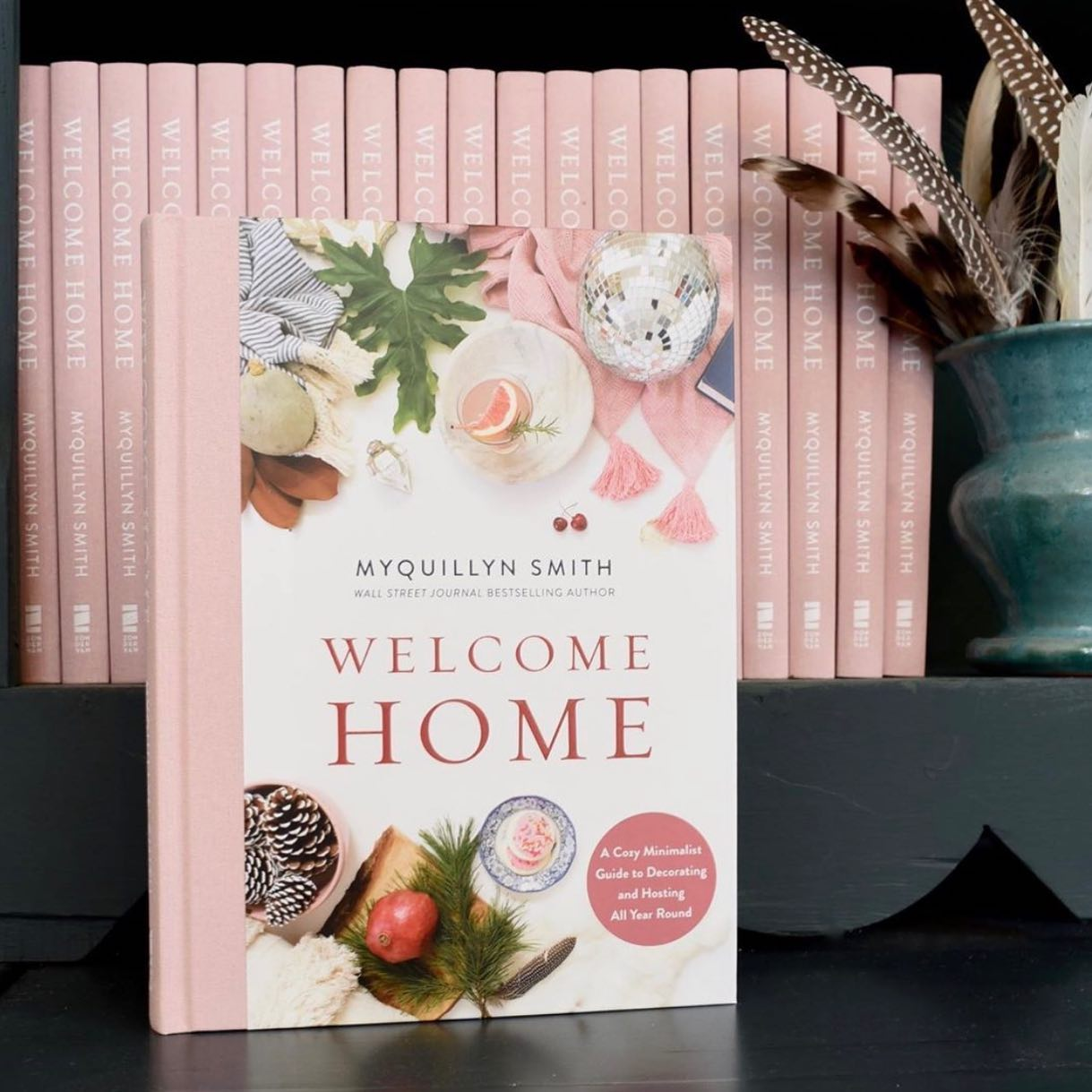 copy of myquillyn's book welcome home in front of multiple other copies