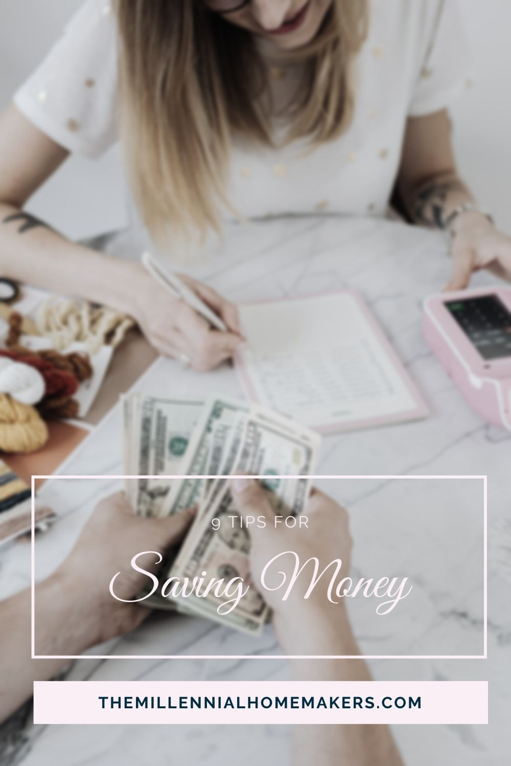 woman writing budget while man counts money