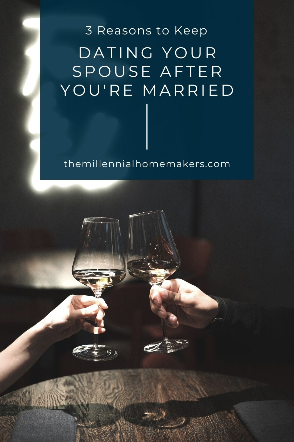 husband and wife clinking wine glasses on date night