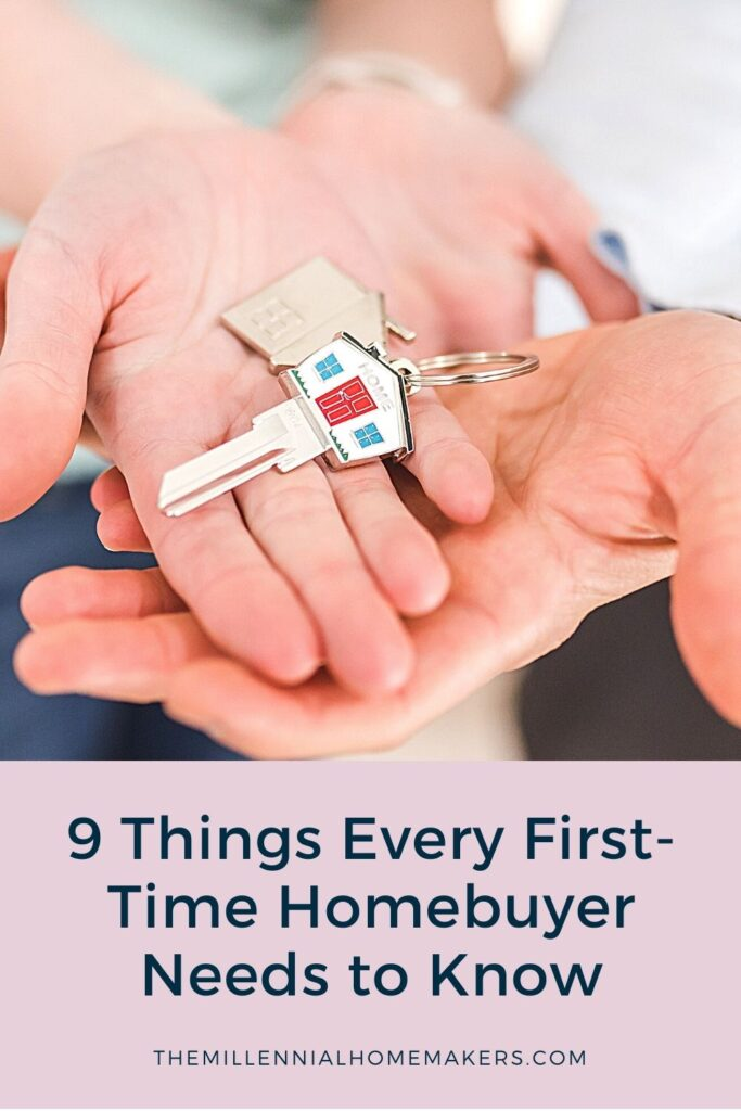 first time homebuyers holding keys to new home