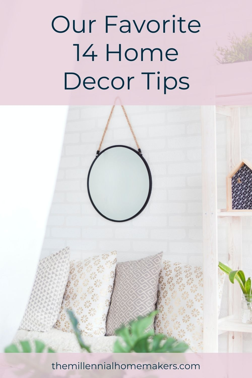 round mirror hanging over an assortment of throw pillows