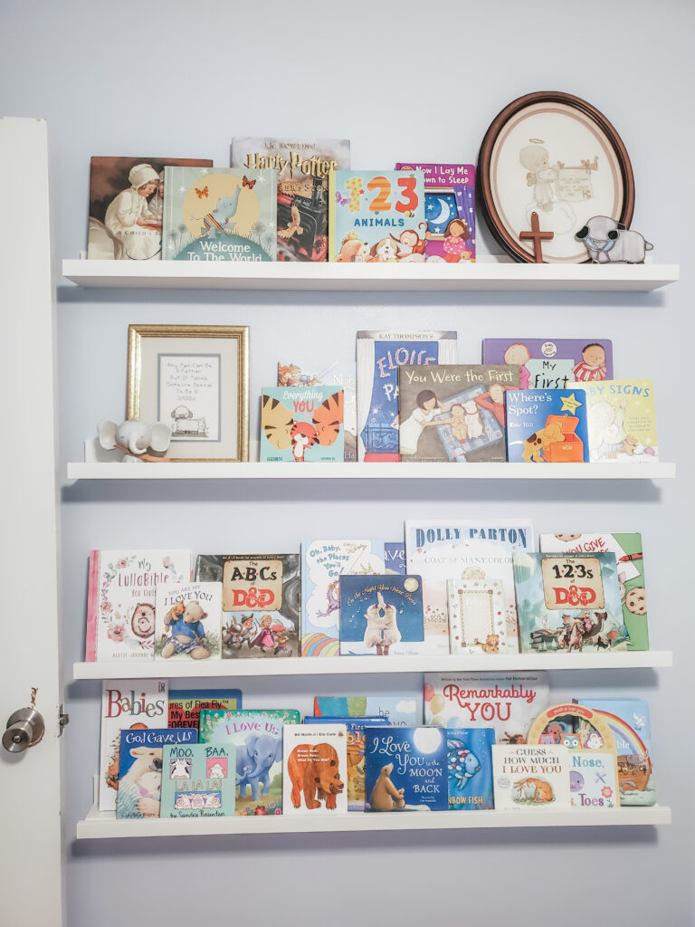 baby girl nursery shelves filled with books