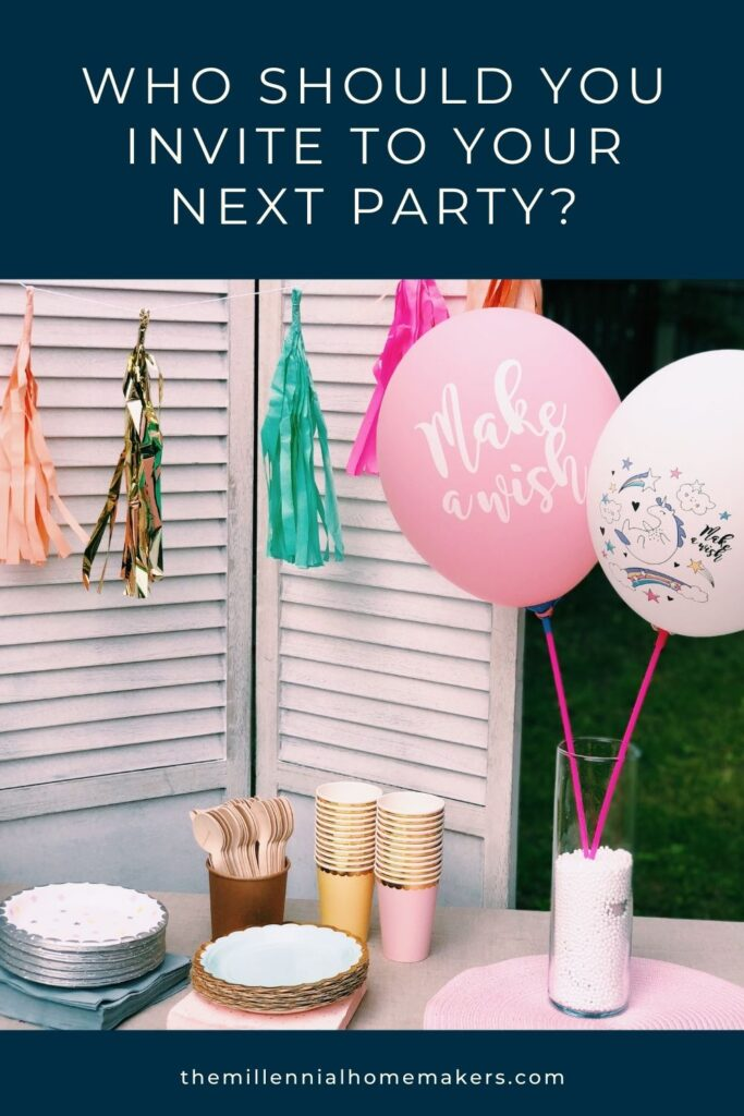 table full of party supplies, including cups, plates, and balloons