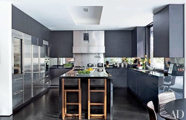 A dark gray modern kitchen after a renovation.