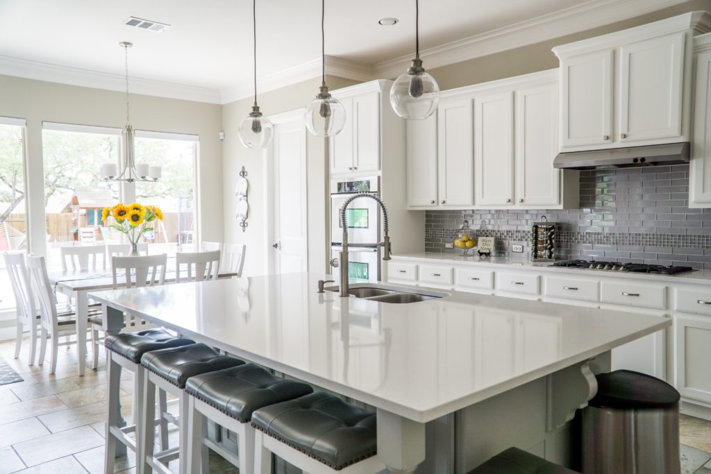 A white kitchen with heated countertops.