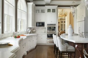 A traditional-style kitchen with curved countertops.