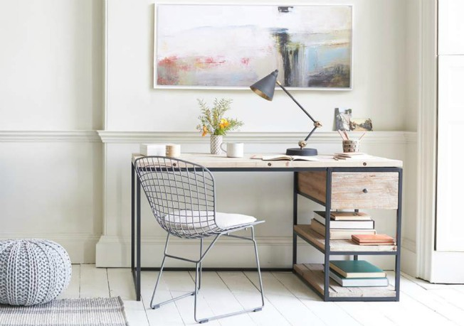 A stone desk in an office with a calm, relaxed style.