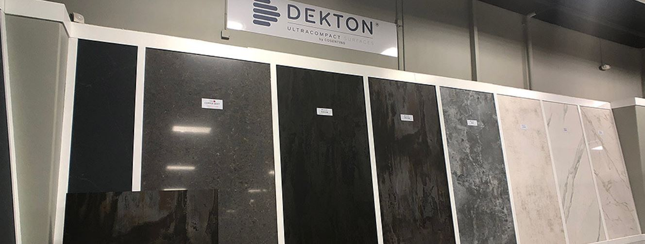 Various color options for Dekton counter tops that resemble stone in a showroom.
