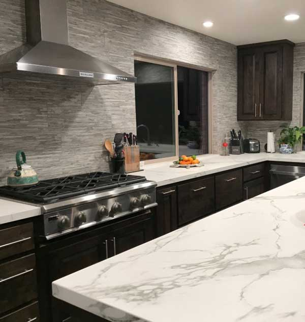 What are Dekton Countertops? They Can resemble quartz like in this kitchen with white counters with grey marbling throughout.