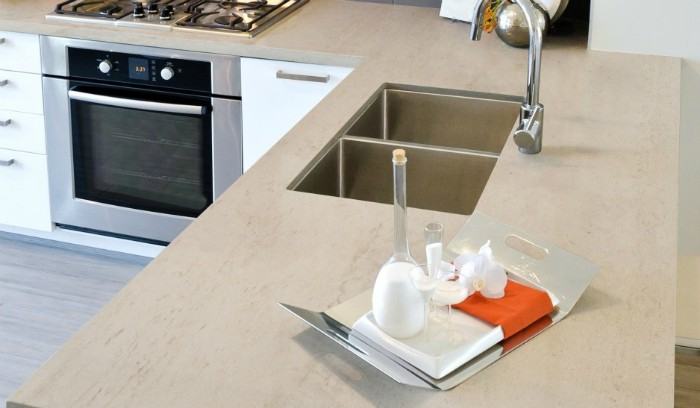 A stage photo of a welcome tray on sand-colored Dekton countertops.