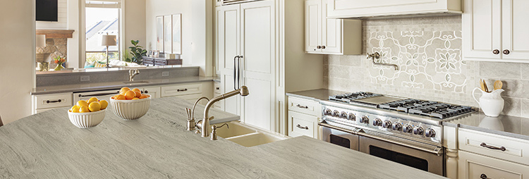 A traditional kitchen with light gray Dekton counters