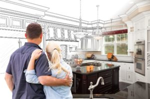 A couple in a kitchen that is half of a design plan and half real.