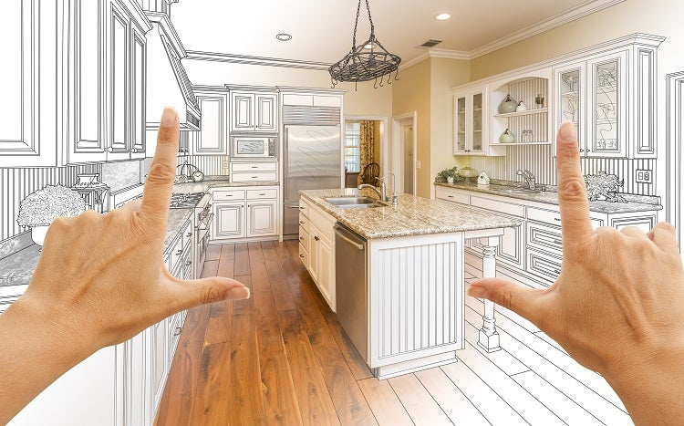 """person holding up their hands in the shape of """"L's"""" envisioning new kitchen layout"""