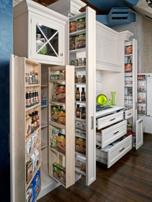 large and elaborate food storage compartment area in a kitchen space