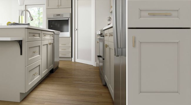 modern kitchen interior with hardwood flooring and off white cabinets