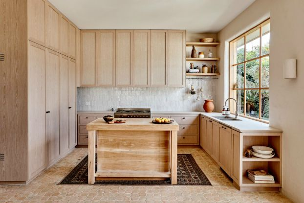 modern kitchen with natural wood amenities throughout