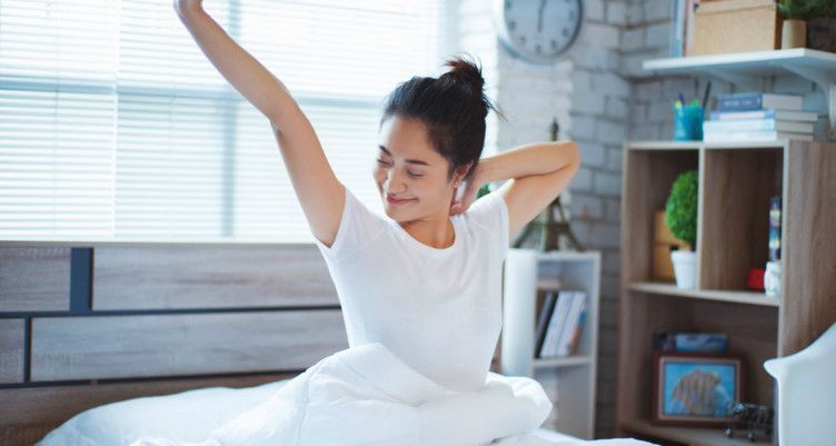woman stretching after waking up