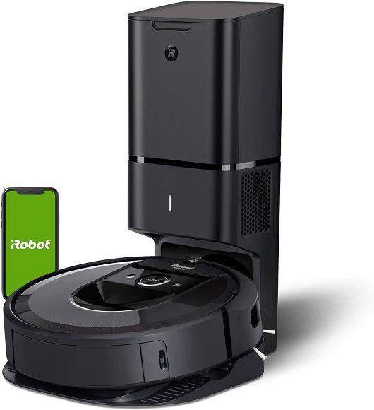 black iRobot brand floor cleaner on docking station