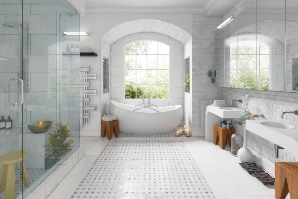 large tile bathroom with soaker tub and glass shower with two sinks