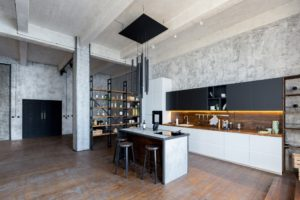 An industrial kitchen featuring concrete walls and clean lines.