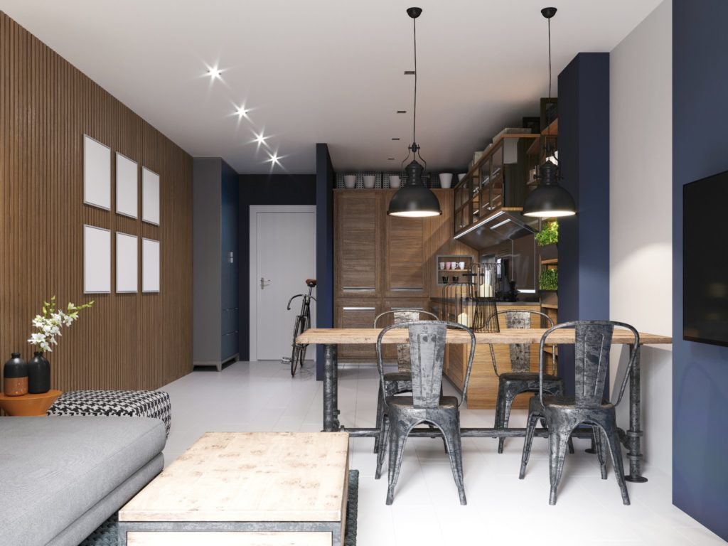 An industrial kitchen with deep blue accent walls.